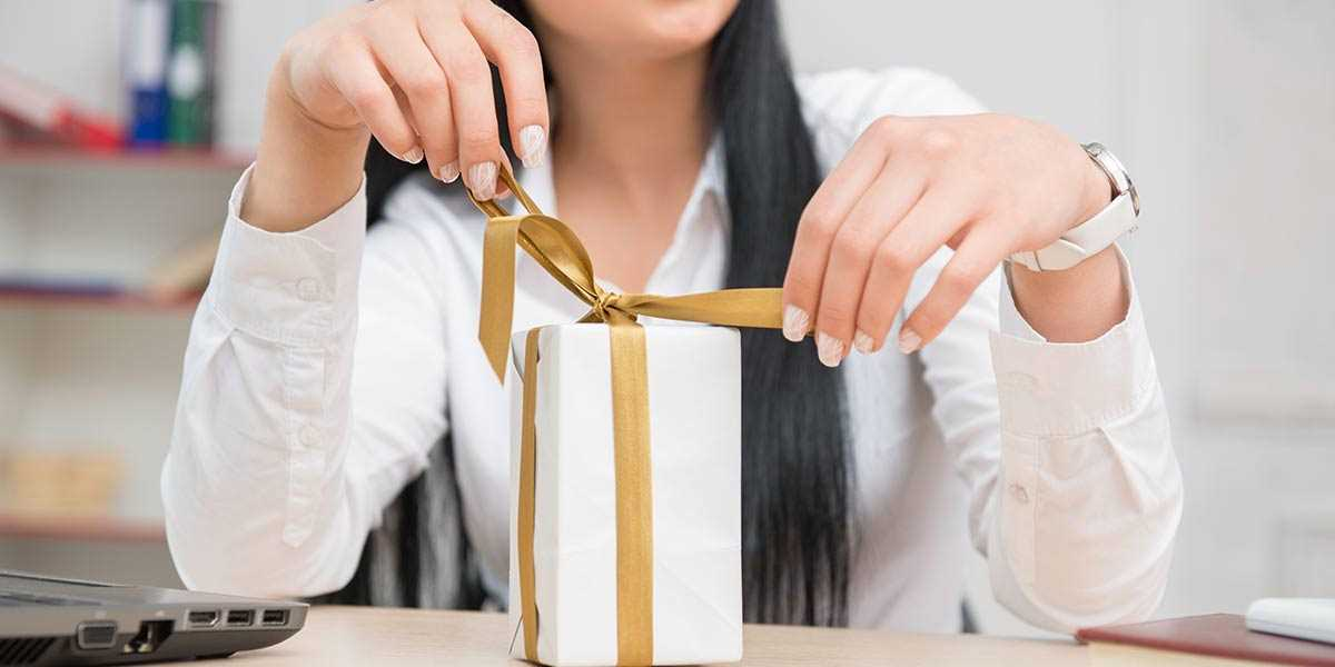 A lady opening her gift