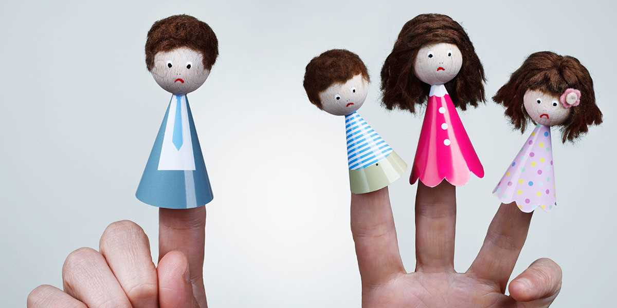 Finger puppets showing a father apart from the family