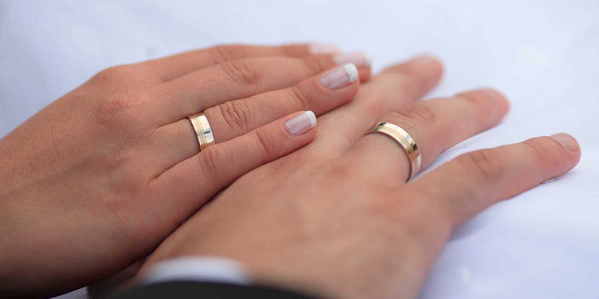 A pair of hands with wedding rings