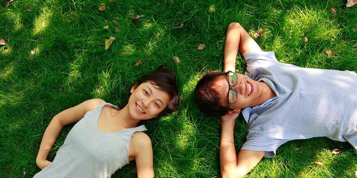 A couple lying on the grass