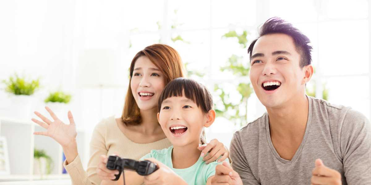 Aunt and Uncle playing video game with niece