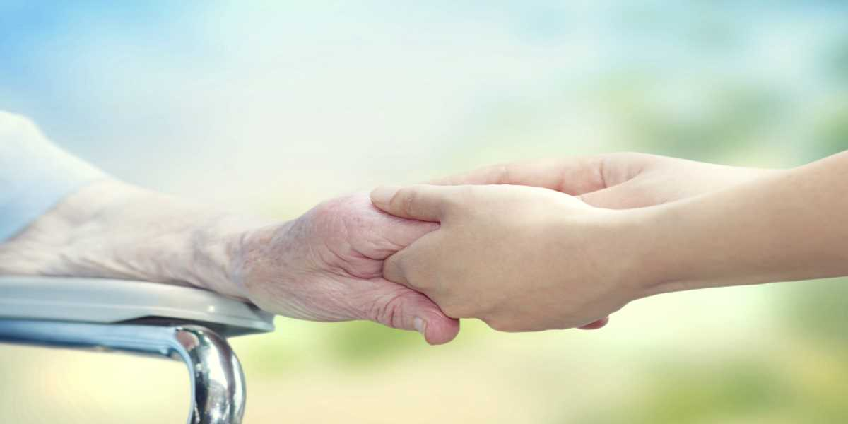 Holding a senior's hands