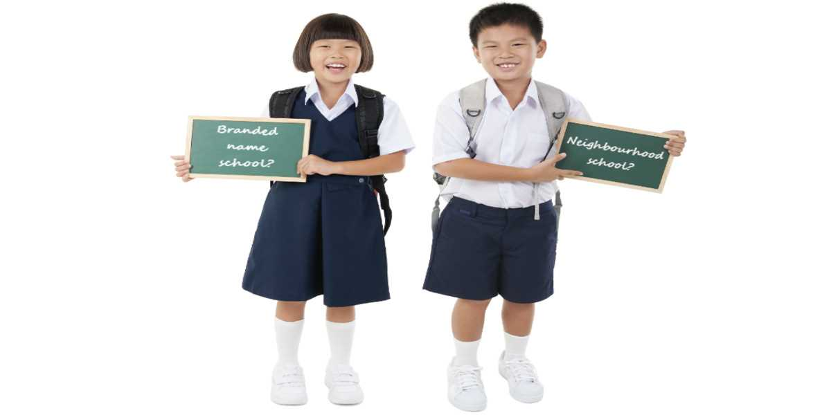 Kids holding up signs of neighbourhood school and branded school