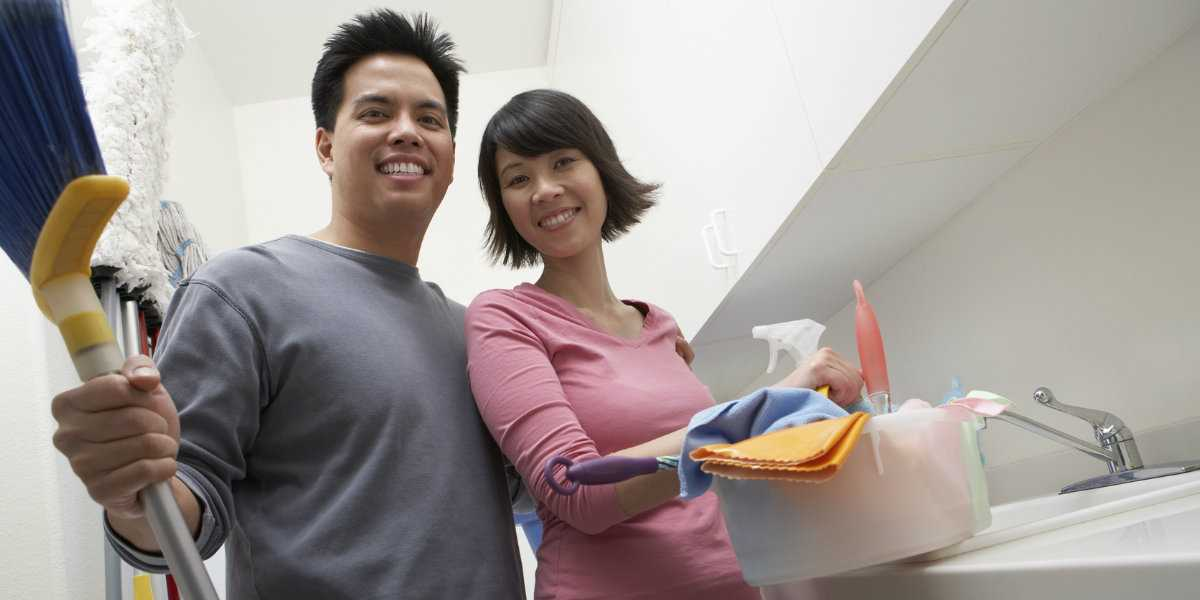 A couple doing household chores together