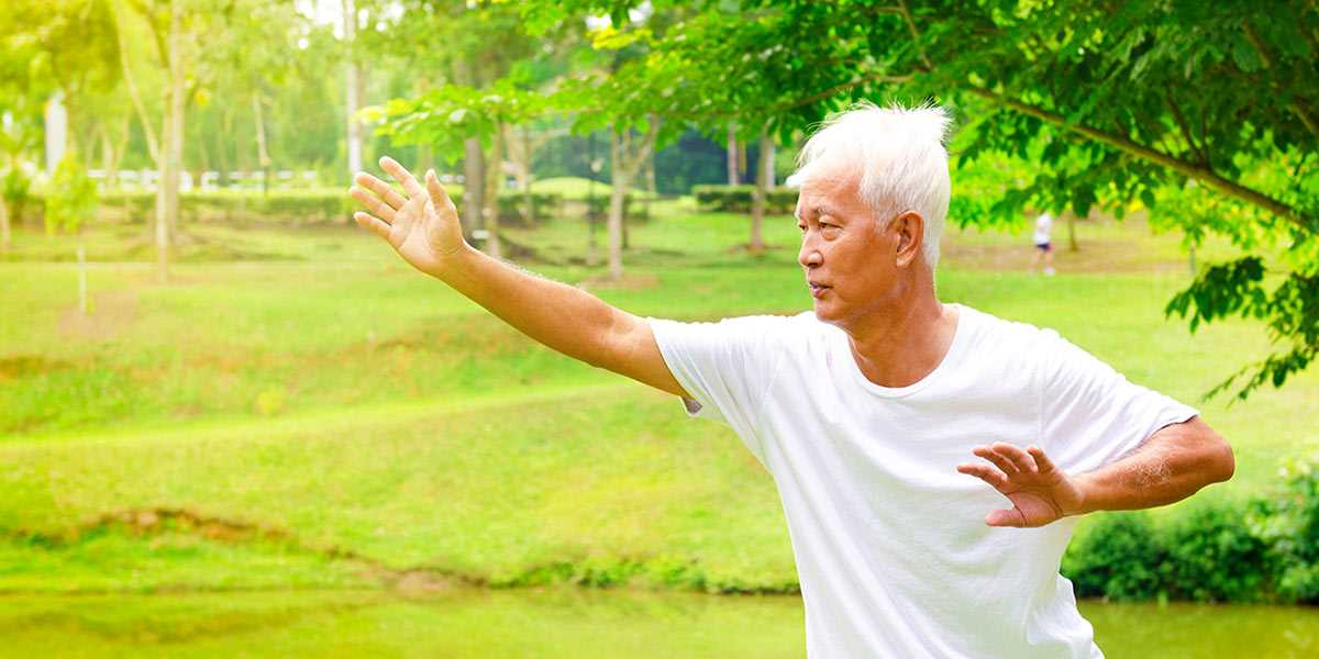 A senior man doing tai chi exercises