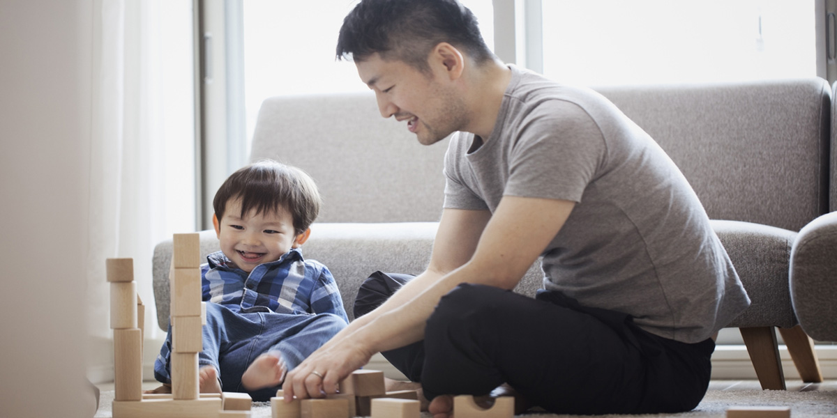 father and son playing wooden blocks