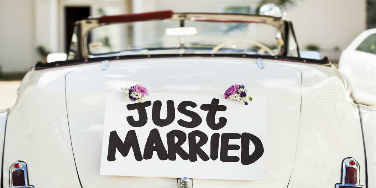"A wedding car with the sign ""Just Married"""