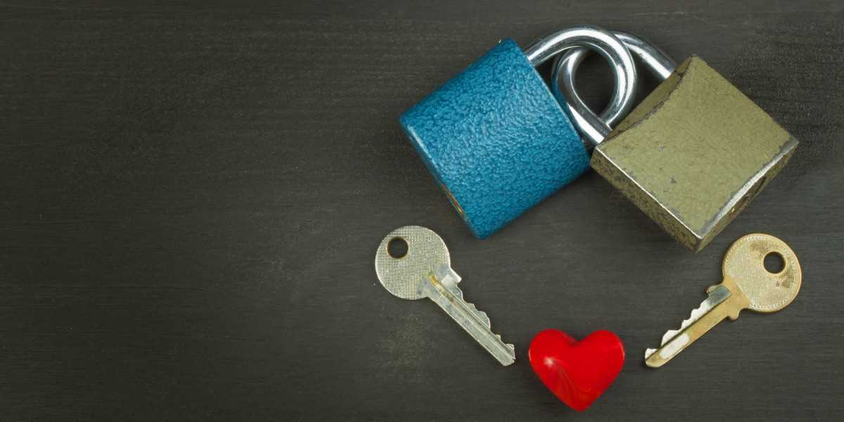 Two locks and two keys with a heart shaped stone