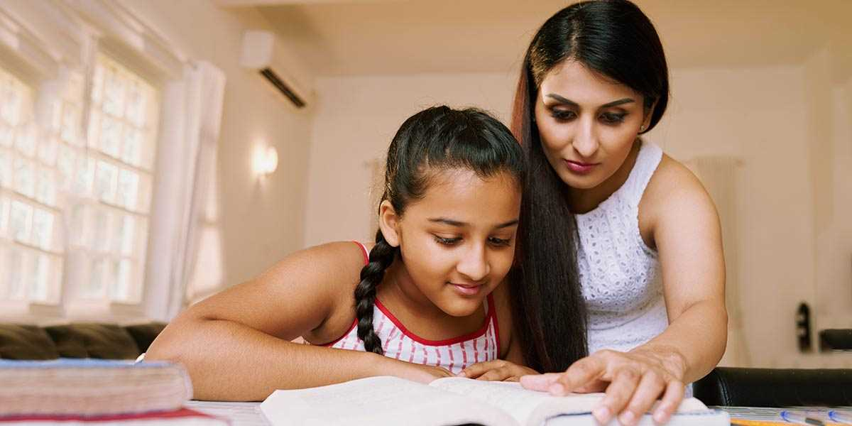 A mother revising schoolwork with her daughter