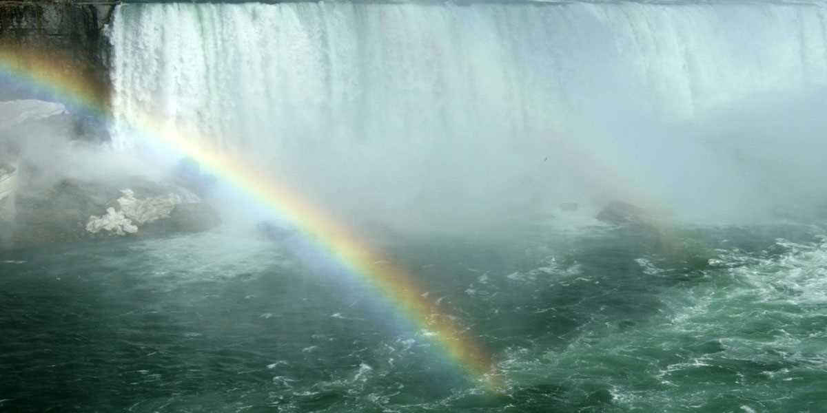 A rainbow over a waterfall