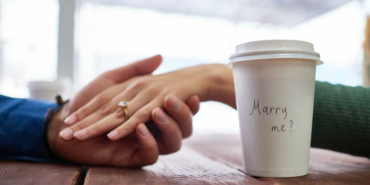 """Marry Me?"" on a coffee cup"