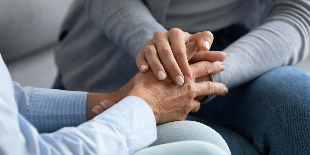Holding seniors hands