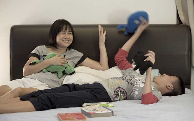 Wei Ping and her son Hong Yang at home